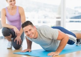 Man doing push ups with female trainer